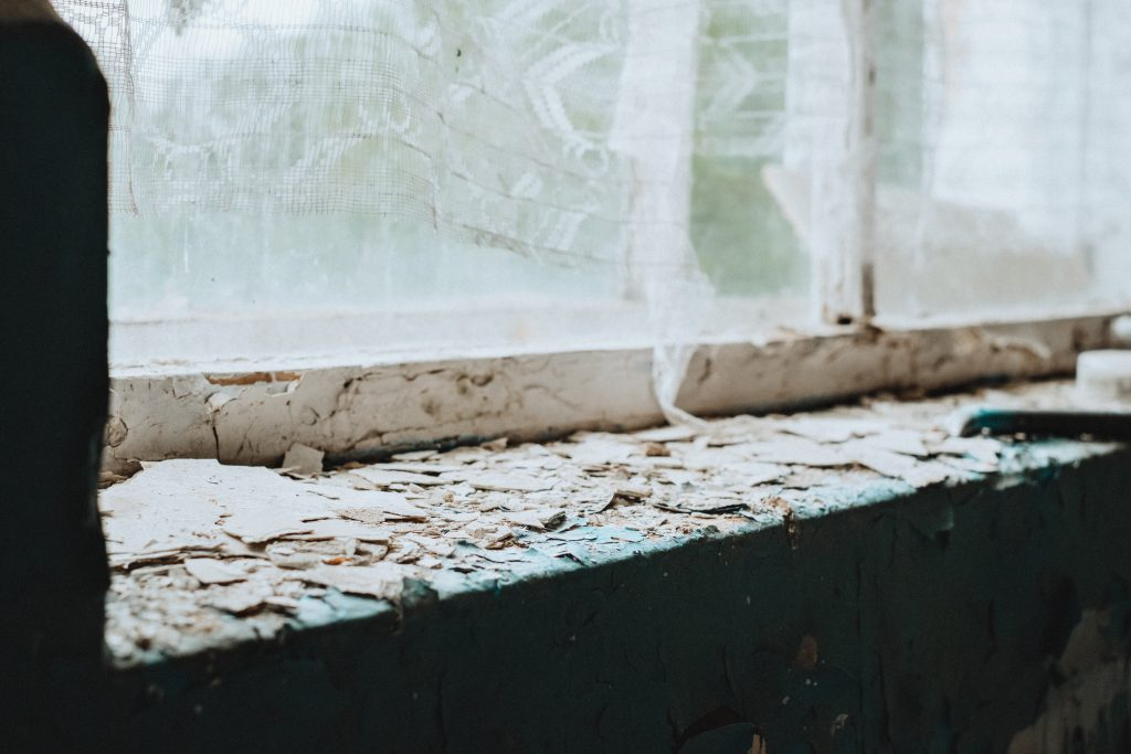 Abandoned ruined building window sill - free stock photo