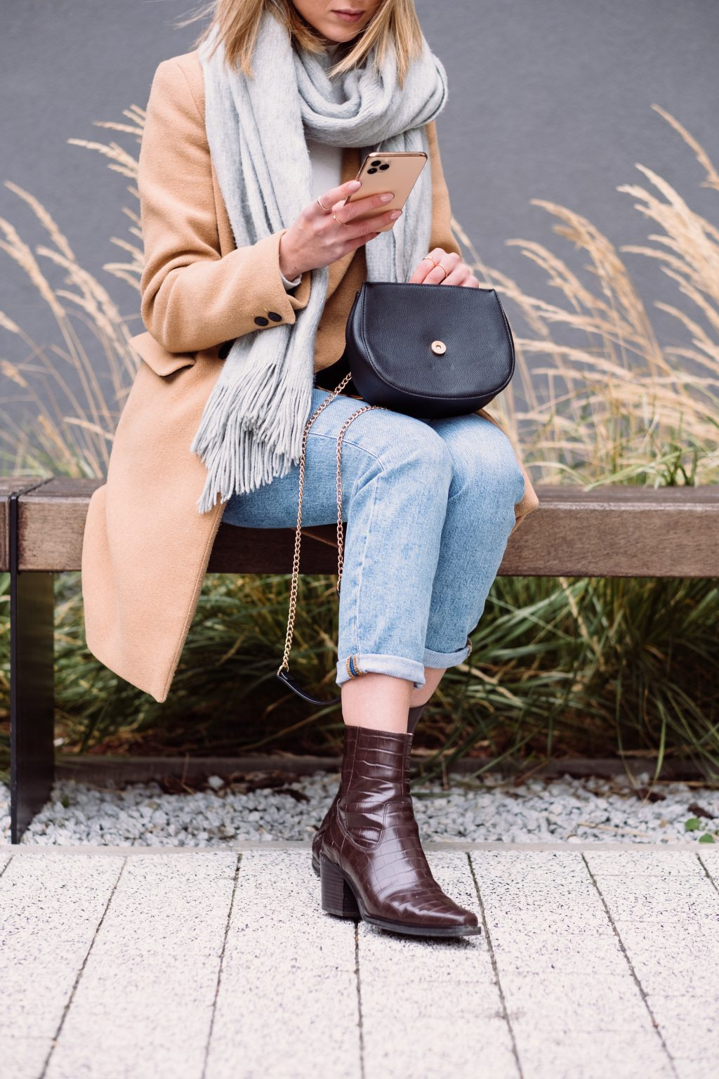 Female holding her phone and purse on an autumn day 2 - free stock photo