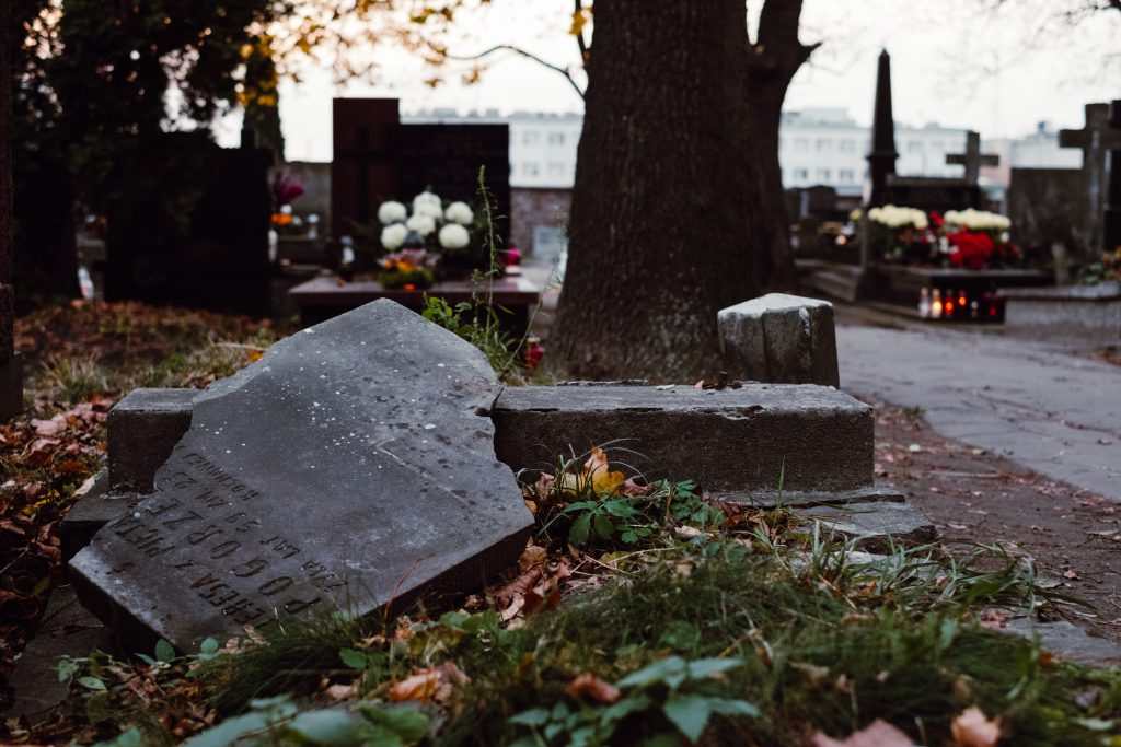 An old damaged grave at the cemetery - free stock photo